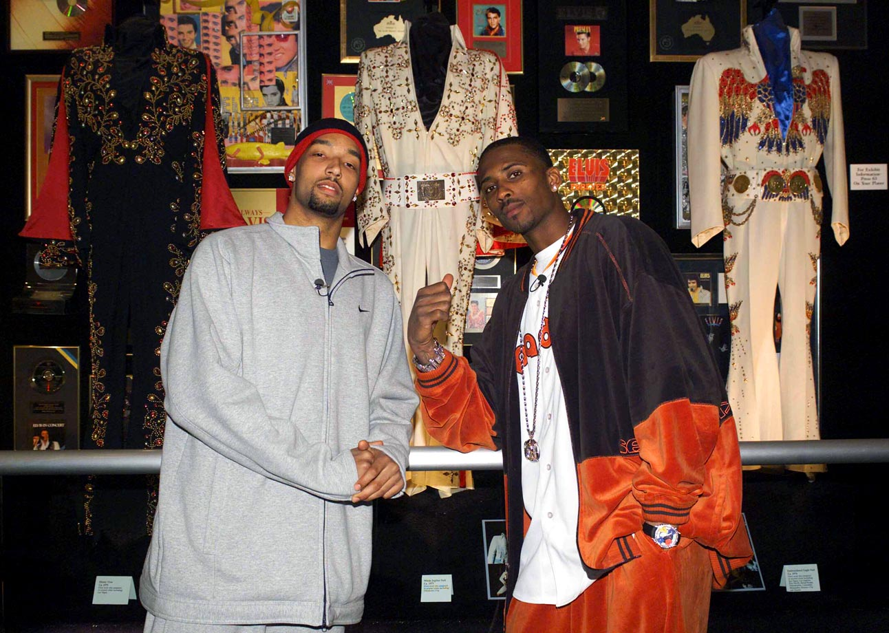 Memphis Grizzlies Drew Gooden and Lorenzen Wright pose with Elvis Presley's suits at his Graceland mansion in Memphis, Tenn., on Jan. 29, 2003.