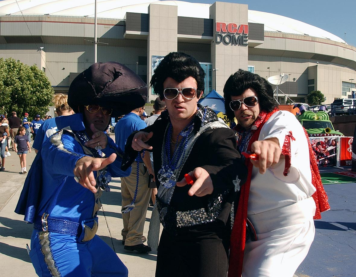 Fans dressed as Elvis pose in front of the RCA Dome before a game between the Indianapolis Colts and the Jacksonville Jaguars at the RCA Dome in Indianapolis on Sept. 21, 2003.