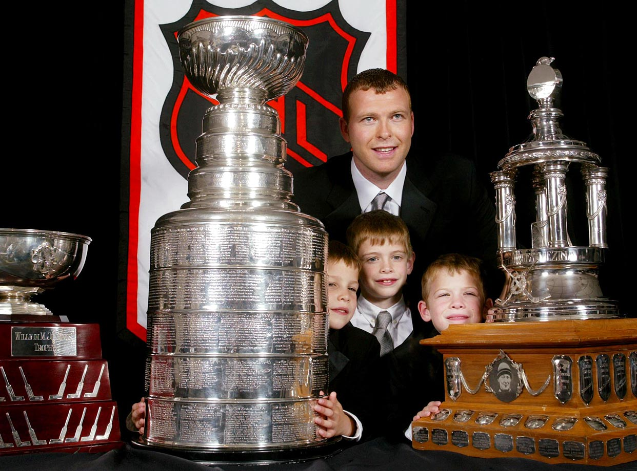 Brodeur, seen here with sons Jeremy, Anthony and William, won his first Vezina Trophy for a 2002-03 campaign in which he became the first NHL netminder to have four 40-win seasons (surpassing Sawchuk and Jacques Plante). He was a complete miser in the postseason, setting an NHL mark of seven shutouts, including three vs. Anaheim in the finals, as the Devils won their third Stanley Cup.