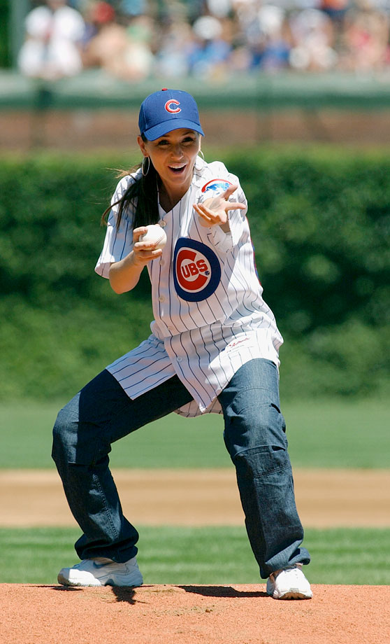 Shania Twain gets ready to throw out the ceremonial first pitch before the Chicago Cubs take on the Philadelphia Phillies on July 24, 2003 at Wrigley Field in Chicago.