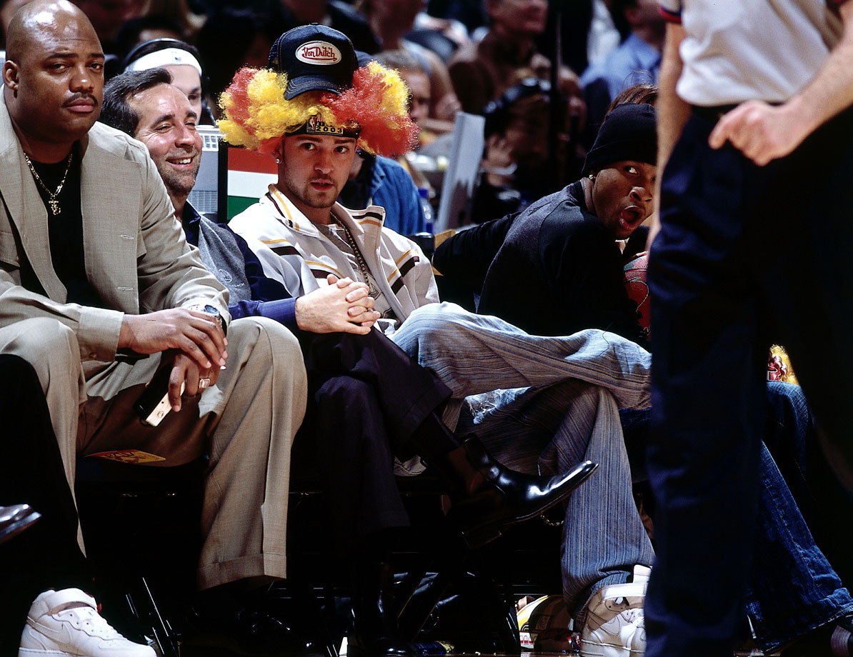 Justin Timberlake and Usher sit courtside during the NBA All-Star Game at Phillips Arena in Atlanta on Feb. 9, 2003.