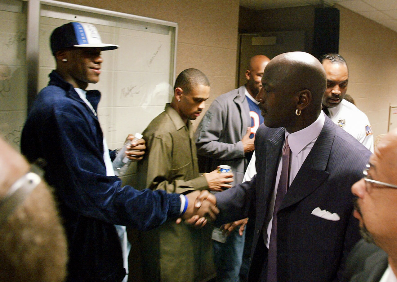 LeBron got to meet Michael Jordan while His Airness was still playing. Jordan had just finished playing against the Cavaliers in this 2003 picture.