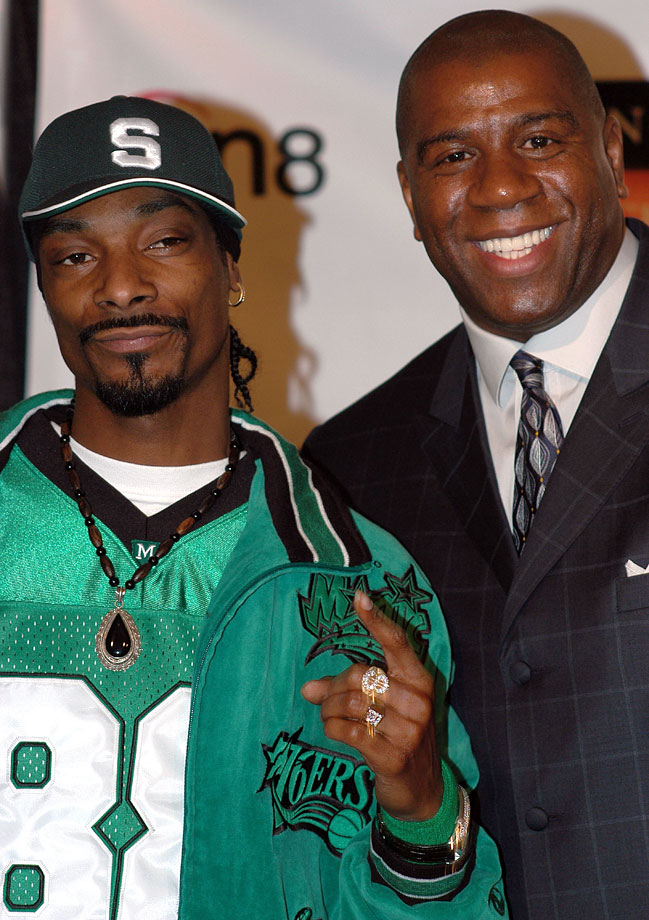 Snoop Dogg and Magic Johnson pose together during the 4th Annual Hoop Magic Celebrity All-Star Game on Feb. 14, 2004 at The Great Western Forum in Los Angeles.
