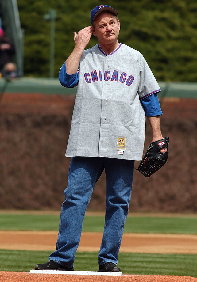 Bill Murray gestures to the crowd before throwing out the ceremonial first pitch for the Chicago Cubs home opener against the Pittsburgh Pirates on April 12, 2004 at Wrigley Field in Chicago.