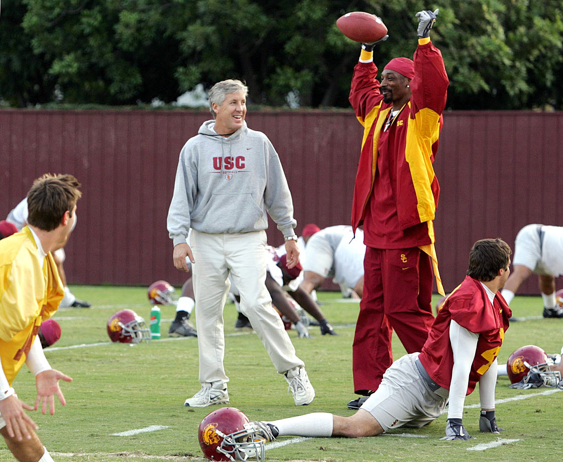 Snoop Dogg visits a USC football team practice with head coach Pete Carroll on Nov. 16, 2004 in Los Angeles.