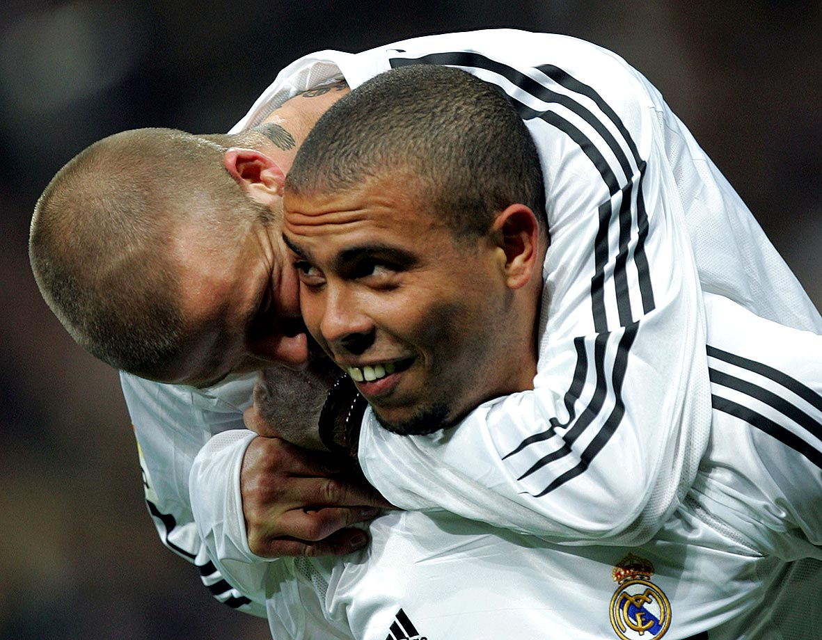 Ronaldo celebrates with Real Madrid teammate David Beckham after he scored a goal during their La Liga match against Levante at the Santiago Bernabeu in 2004.