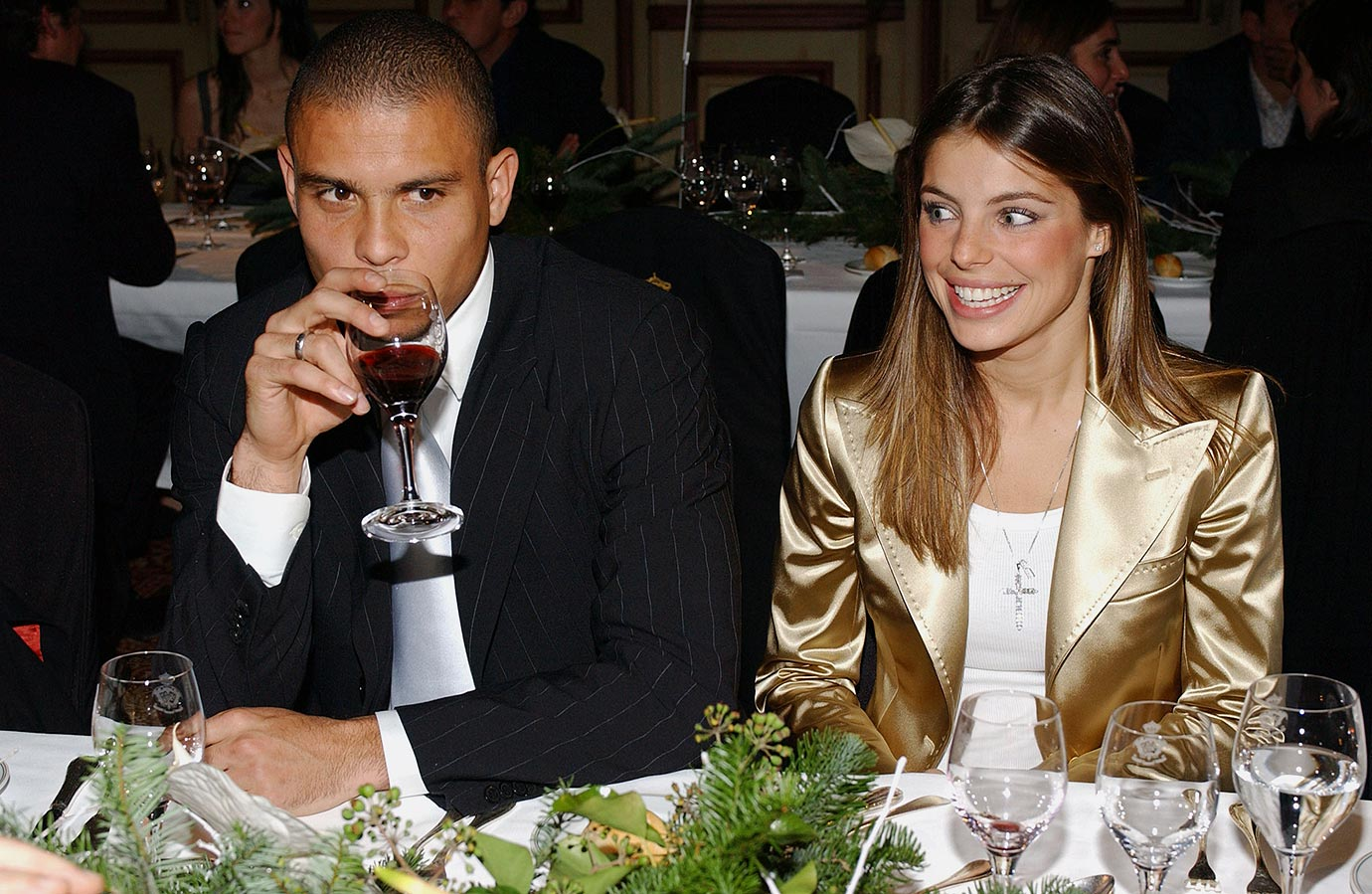 Ronaldo, donning a sleek pinstripe suit, attends the GQ Awards 2004 in Madrid with his then girlfriend Daniela Cicarelli.