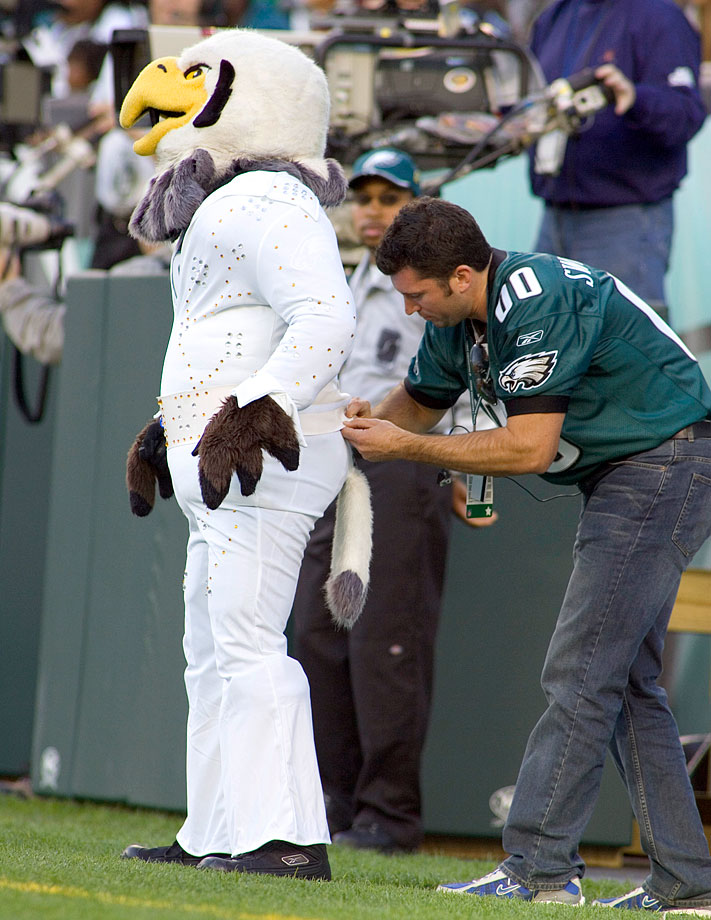 The Philadelphia Eagles mascot gets a costume adjustment as Elvis for Halloween during a game against the Baltimore Ravens at Lincoln Financial Field in Philadelphia on Oct. 31, 2004.