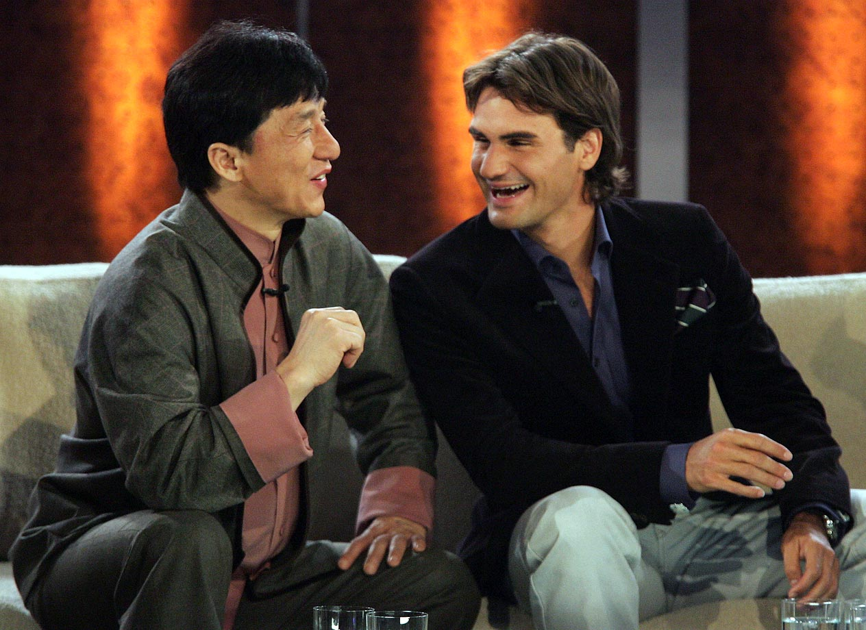 Jackie Chan and Roger Federer share a laugh on the ''Wetten Dass...?'' television entertainment show at the Messehalle in Nuremburg, Germany, on Dec. 11 2004.