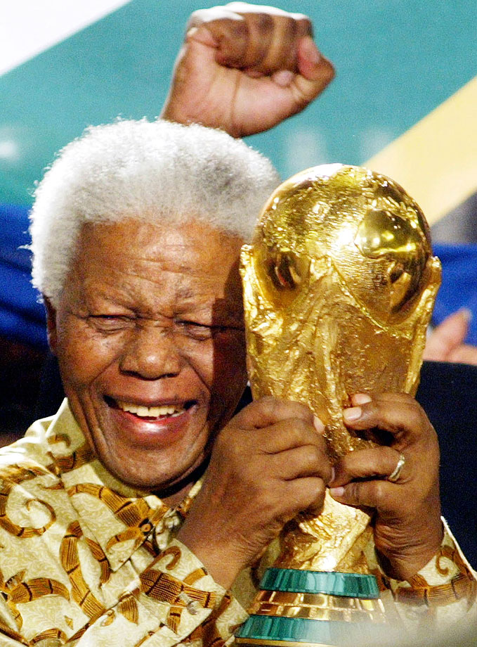 Mandela raises the World Cup trophy after learning South Africa had won the honor of playing host to the 2010 tournament.