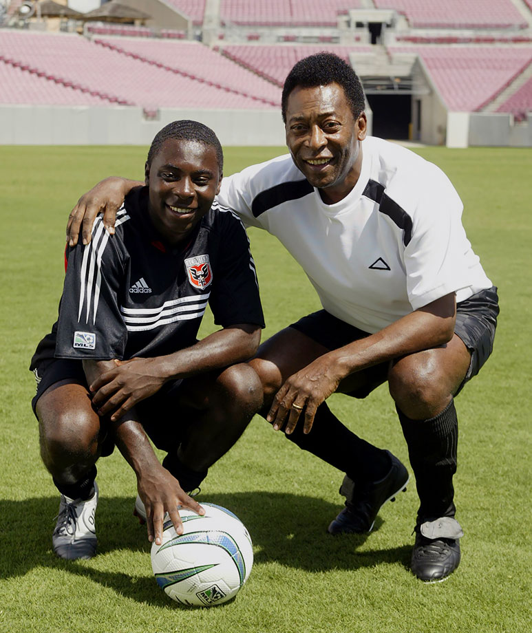 Pelé poses with DC United's Freddy Adu during a photo shoot while filming a Sierra Mist commercial on March 6, 2004 at Raymond James Stadium in Tampa, Fla.