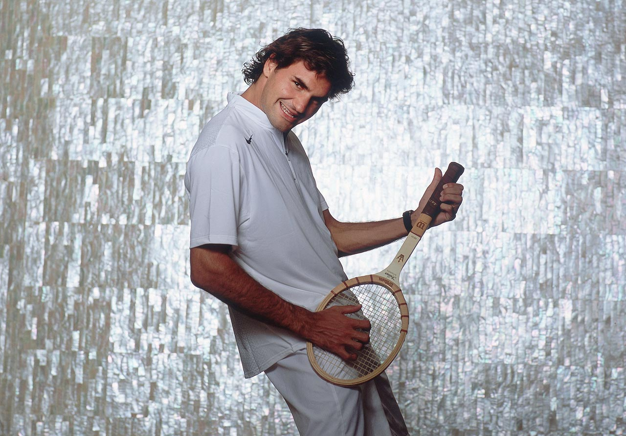 Roger Federer holds a tennis racquet like a guitar during an SI photo shoot in Sydney, Australia, on Dec. 21 2004.