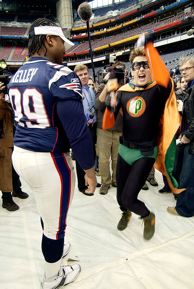 Patriots defensive tackle Ethan Kelley watches Nickelodeon's Pick Boy dance during Media Day for Super Bowl XXXVIII in Houston.