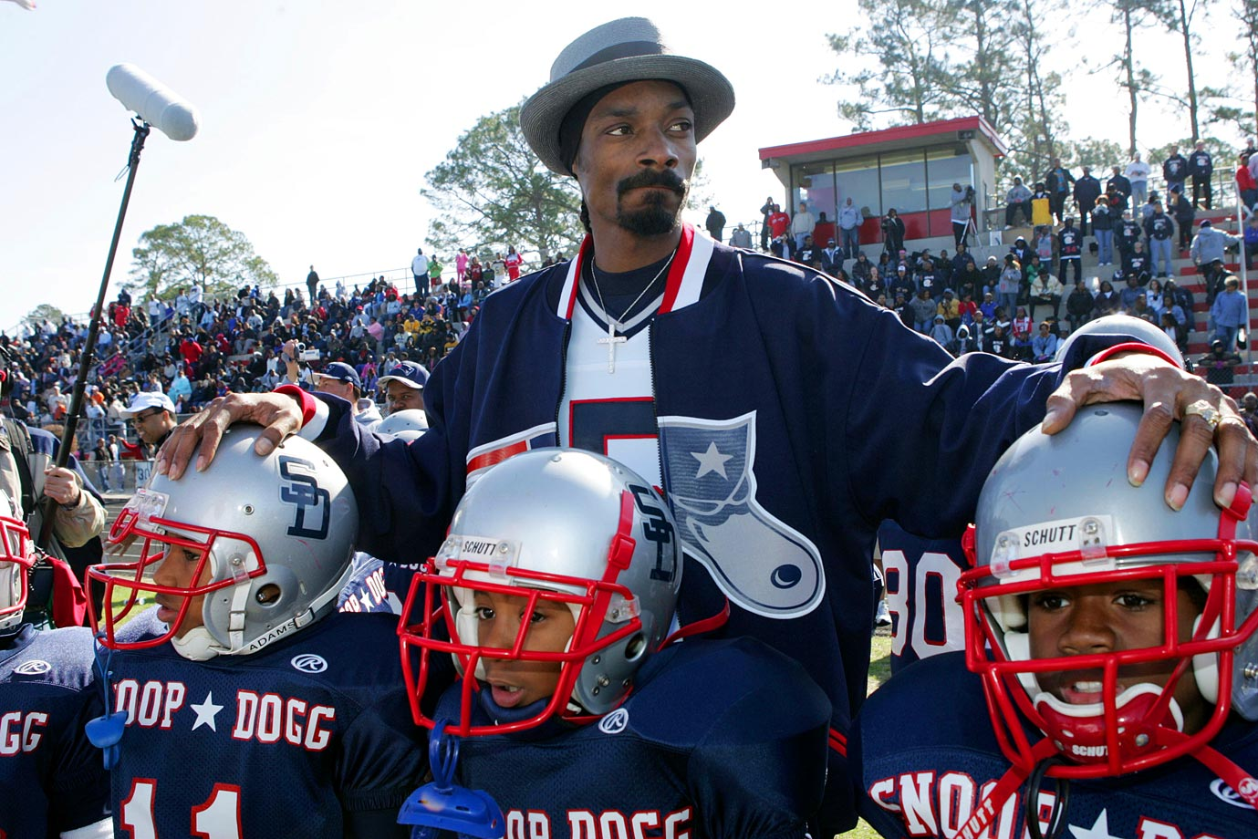 "Snoop Dogg poses with his players during the ""Snooper Bowl"" on Feb. 5, 2005 at William M. Raines High School in Jacksonville, Fla."