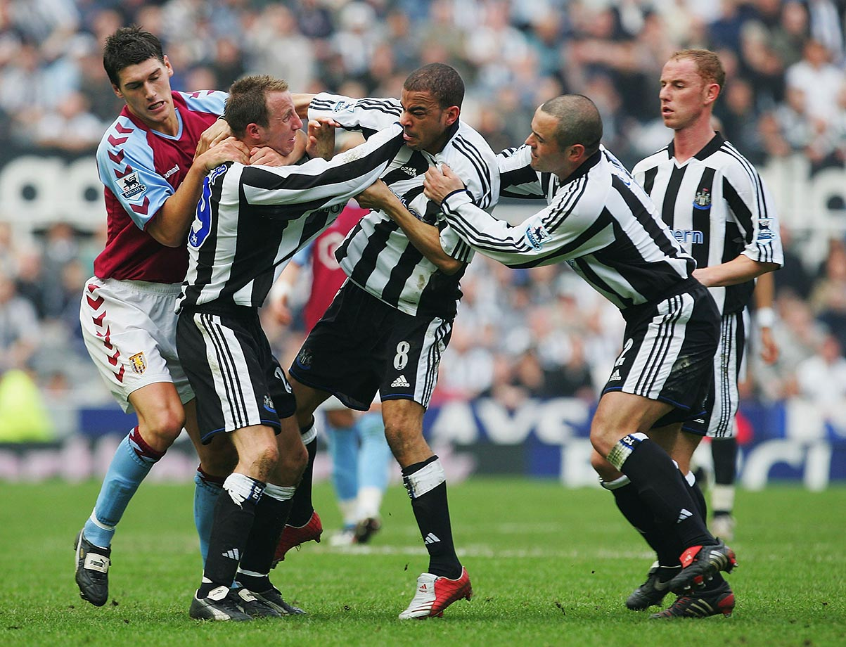 The Newcastle United teammates' frustration with each other got the better of them during a 2005 FA Barclays Premiership match against Aston Villa in Newcastle, England. Exchanging blows shortly after their team took a 3-0 lead en route to a victory by the same score, the pair received red cards and continued their scrape in the dressing room. Two hulking team masseurs finally broke it up.
