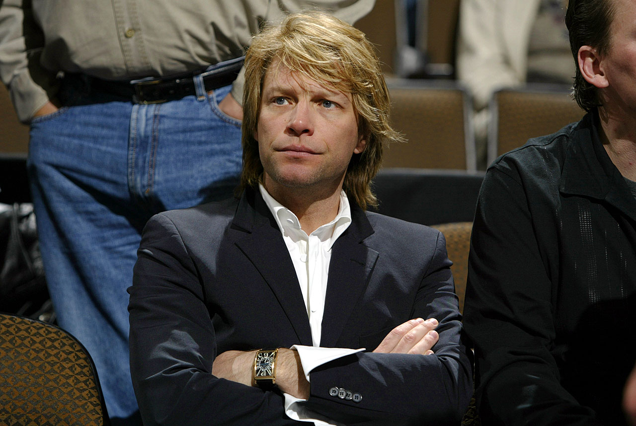 Jon Bon Jovi watches the Denver Nuggets game against the Seattle SuperSonics at the Pepsi Center in Denver.