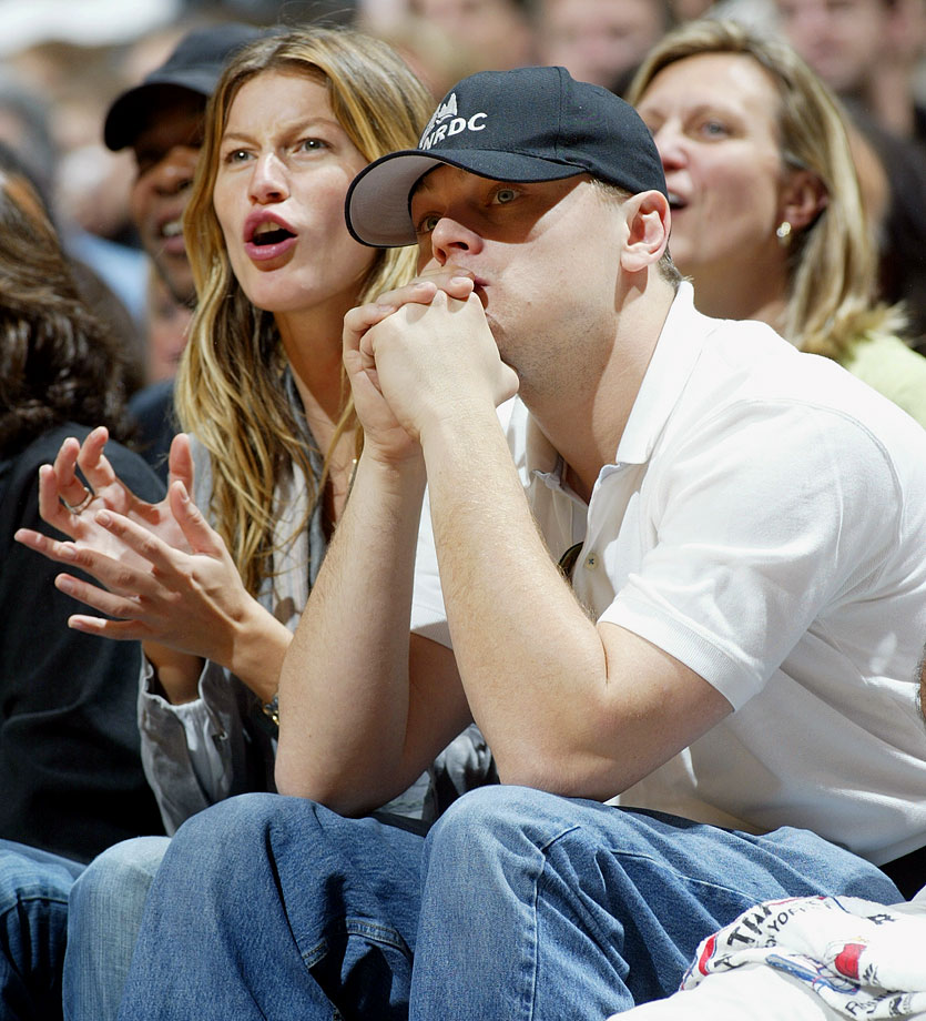 Leonardo DiCaprio and Gisele Bundchen watch the New Jersey Nets play the Miami Heat in Game 4 of the Eastern Conference Quarterfinals at the Continental Airlines Arena in East Rutherford, N.J.