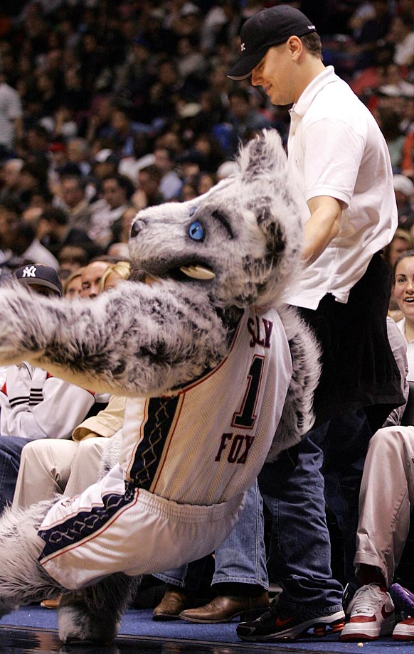 New Jersey Nets mascot Sly the Silver Fox pretends to faint at the sight of Leonardo DiCaprio during Game 4 of the Eastern Conference Quarterfinals against the Miami Heat at the Continental Airlines Arena in East Rutherford, N.J.