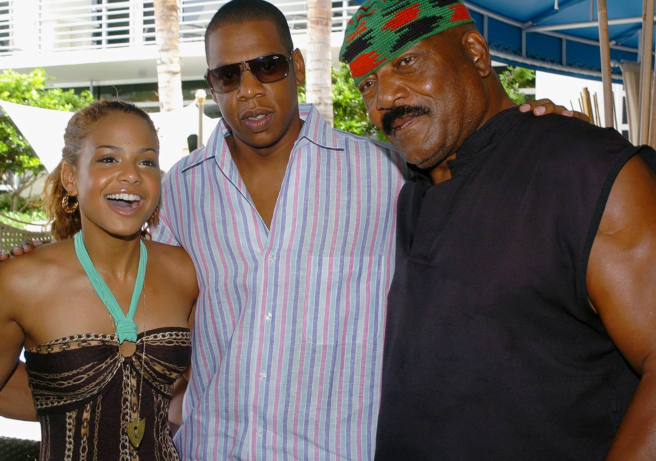 Christina Milian, Jay-Z and Jim Brown pose together during a party hosted by Ocean Drive magazine at the Ritz-Carlton, South Beach hotel in Miami Beach, a day before the MTV Video Music Awards.