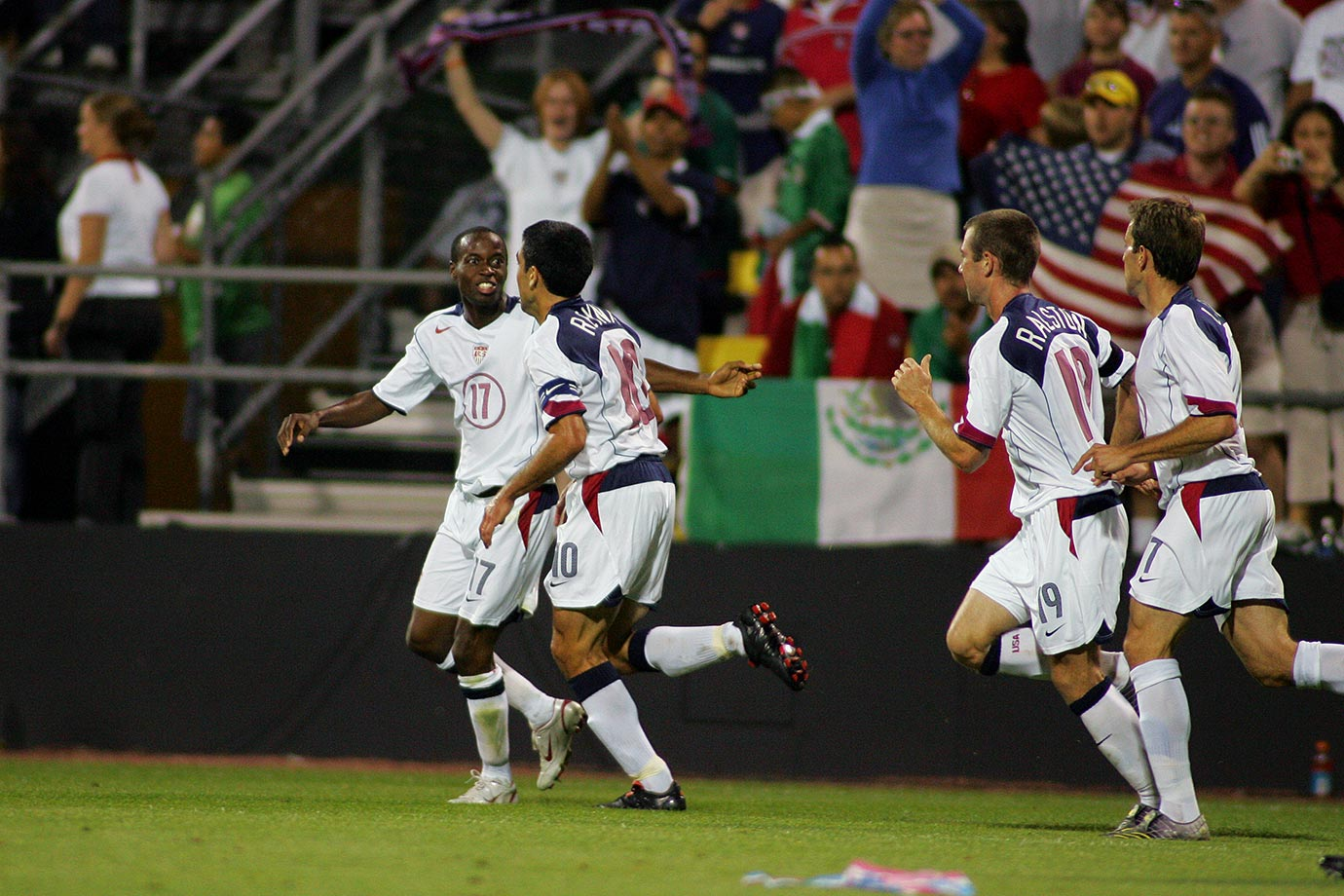 "A 2-0 victory over ""El Tri"" clinched a spot in the 2006 World Cup, with goals coming from Steve Ralston and DaMarcus Beasley."