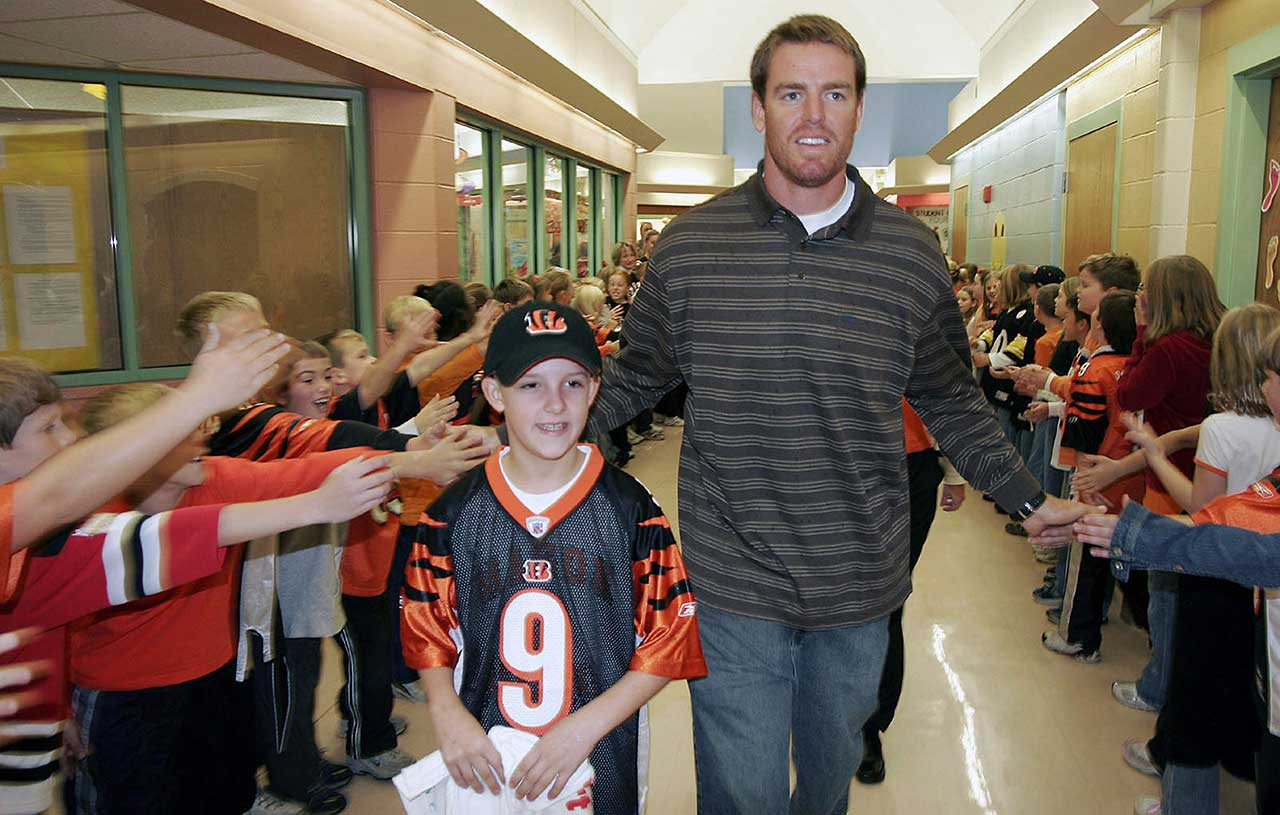 Palmer walks with Take A Player to School winner Drew Matula after the QB spoke and answered questions during an assembly at Mason (Ohio) Intermediate School.