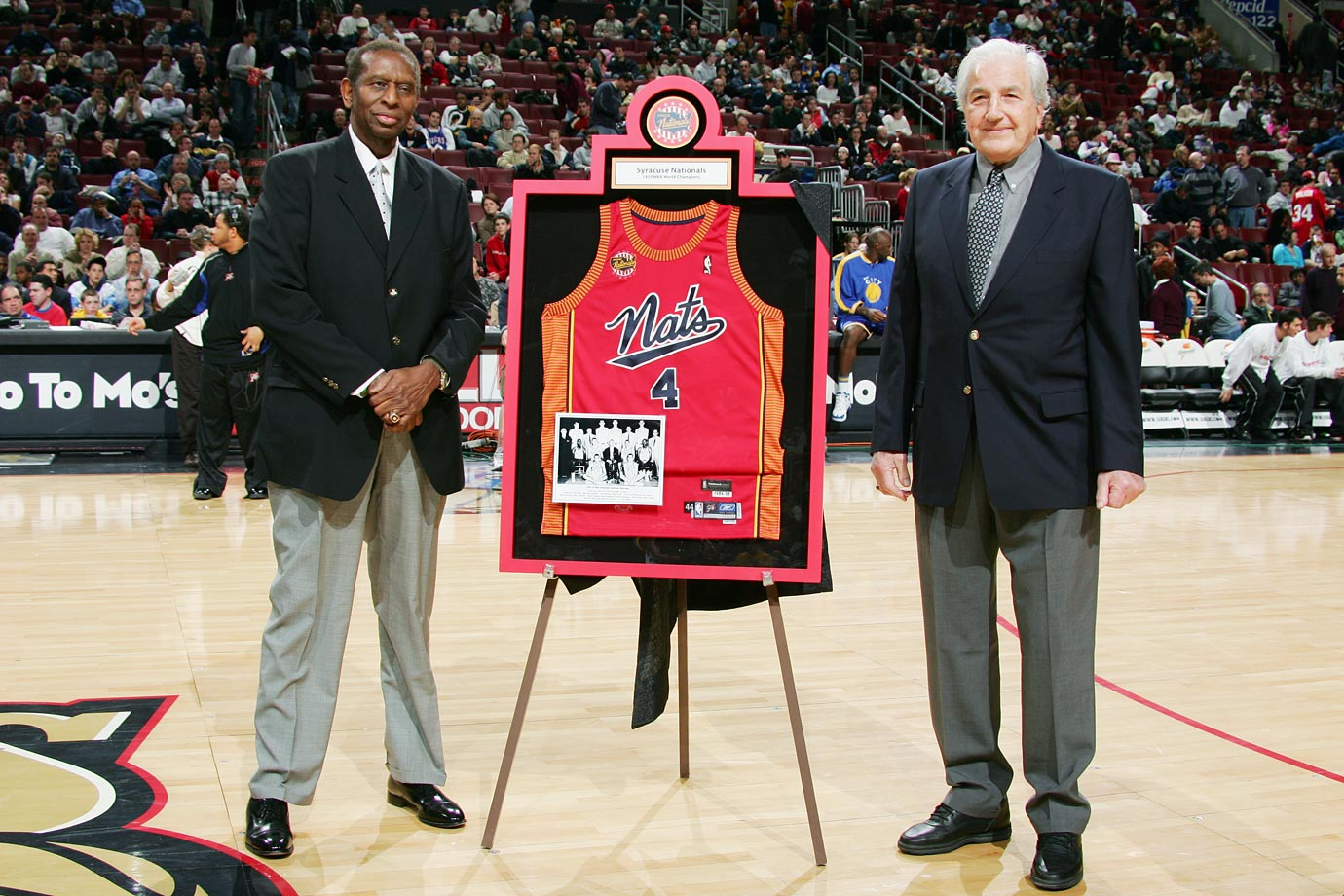Earl Lloyd and Dolph Schayes are honored at a 76ers-Warriors in 2005 at the Wachovia Center in Philadelphia.