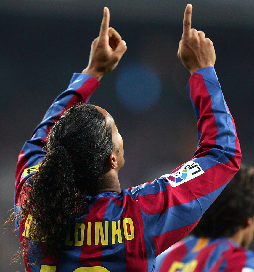 Barcelona's Ronaldinho gets a standing ovation in Madrid during a 3-0 win for Barcelona.