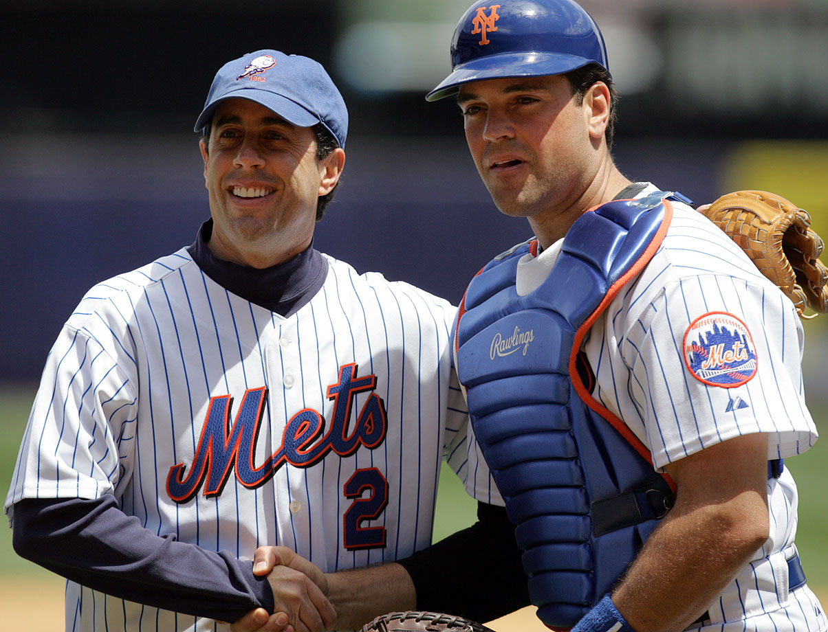 Jerry Seinfeld and Mike Piazza pose together of Seinfeld threw out the first pitch prior to the Mets game against the Yankees in May 2005.