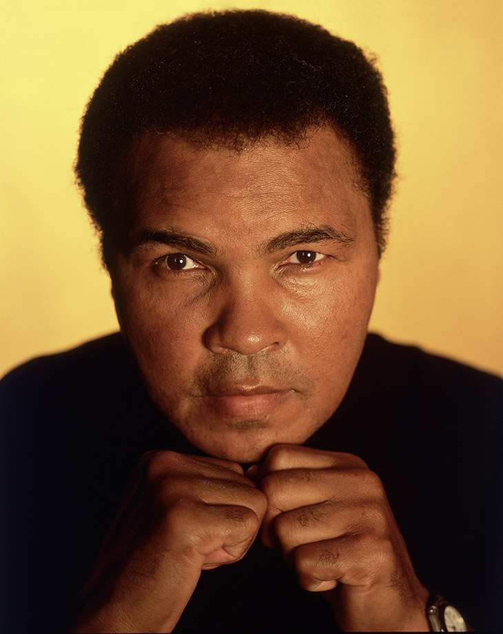 Ali poses with his fists up for a portrait in 2005.