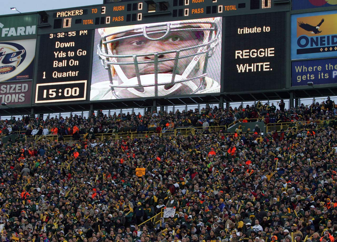 The Green Bay Packers pay a tribute to Reggie White during their NFC playoff game agains the Minnesota Vikings at Lambeau Field on Jan. 9, 2005 in Green Bay, Wis.