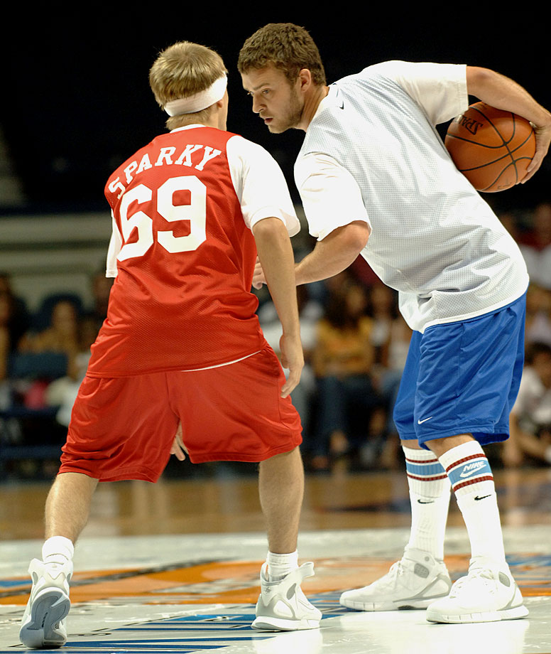 Aaron Carter defends against Justin Timberlake during *NSYNC's Challenge for the Children VII Celebrity Basketball Game at Allstate Arena in Chicago on July 16, 2005.