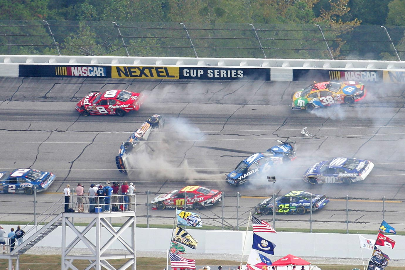 Two cars flipped over in separate accidents. Michael Waltrip was hit by Mark Martin and flipped after being involved in a wreck that began when Jimmie Johnson spun Elliott Sadler. Not long after, Ryan Newman spun Casey Mears, which started a chain reaction resulting in Scott Riggs flipping several times before being hit by Jeff Burton. The race was incident-filled, and Dale Jarrett took his last win in the race. Scenes from this race were used in the movie Talladega Nights: The Ballad of Ricky Bobby and actors from the movie were introduced in driver introductions.