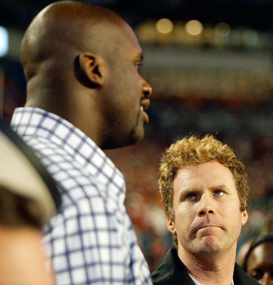 Will Ferrell looks up to Shaquille O'Neal during the BCS National Championship game between the USC Trojans and Oklahoma Sooners on Jan. 4, 2005 at Pro Player Stadium in Miami.