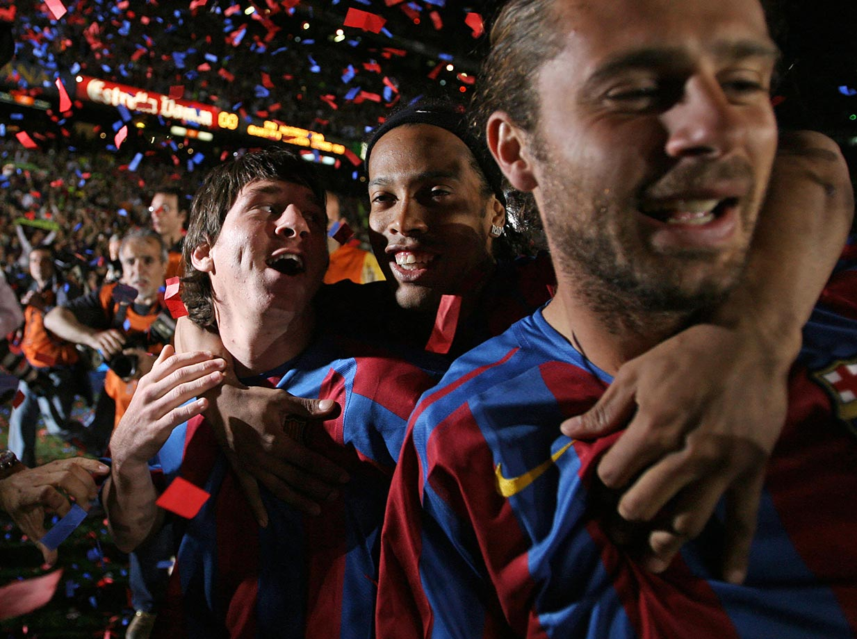 Barcelona's Lionel Messi, Ronaldinho and Rafael Marquez celebrate after defeating Espanyol to win the Spanish League on May 6, 2006 at the Camp Nou stadium in Barcelona, Spain.