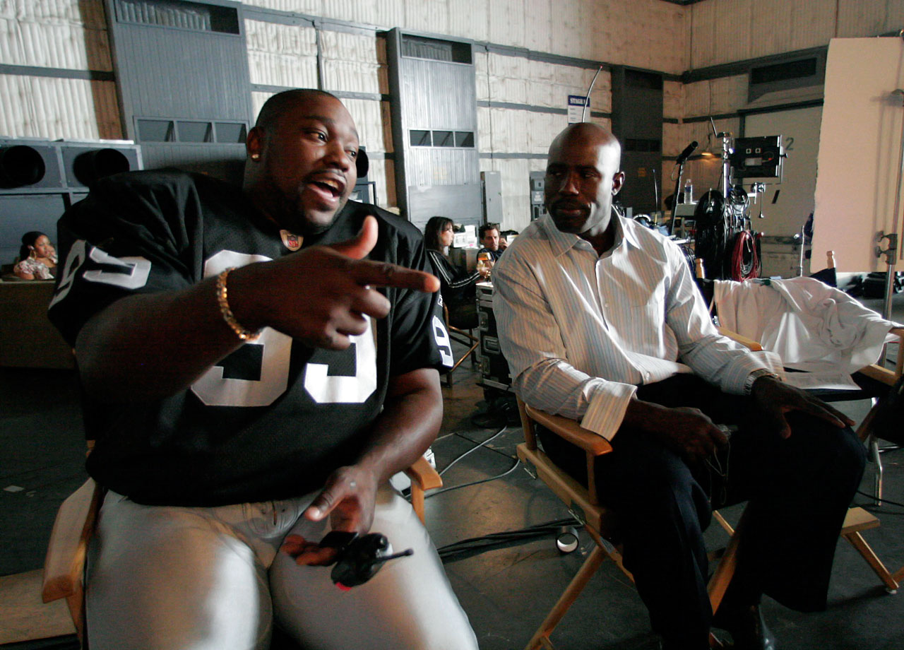 Warren Sapp chats with Terrell Davis prior to filming a commercial for the NFL on June 29, 2006 in Los Angeles.