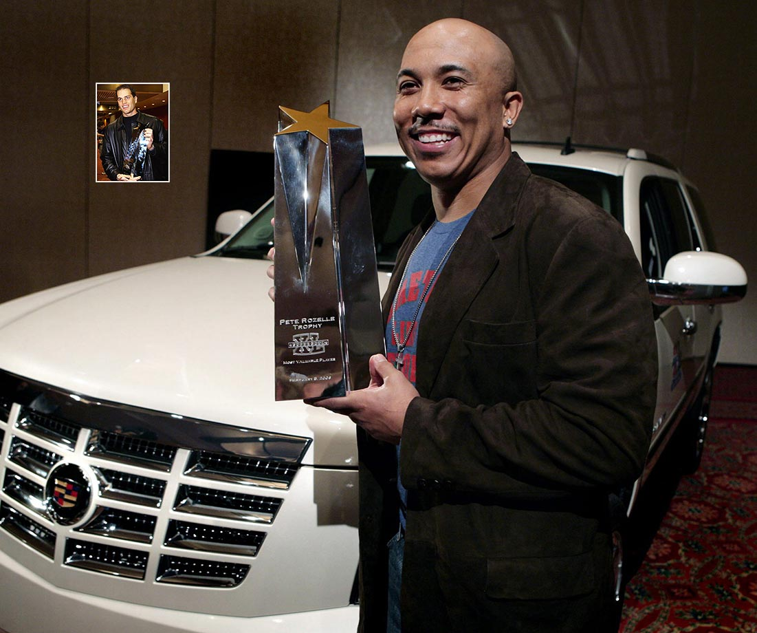 Super Bowl XL MVP Hines Ward of the Pittsburgh Steelers holds the Pete Rozelle trophy as he stands with his new 2007 Cadillac Escalade.