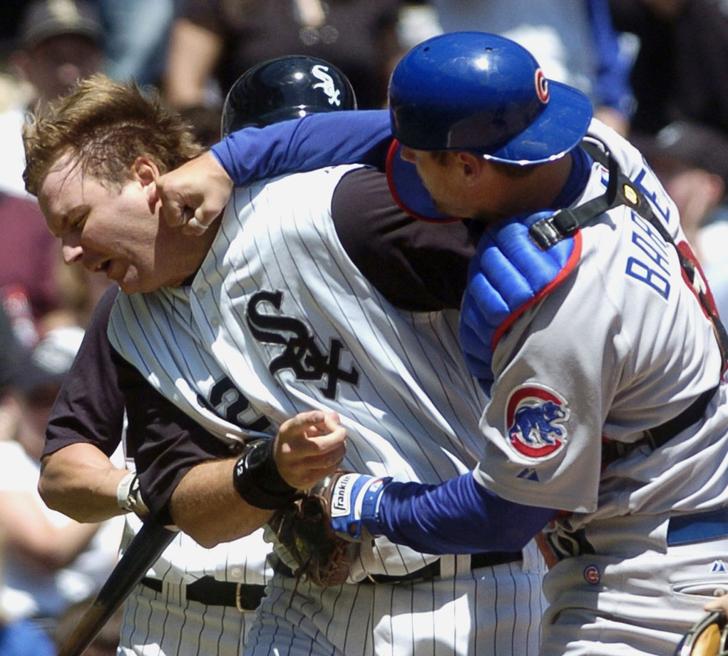 "Cubs catcher Michael Barrett didn't take too kindly to being run over at the plate by his counterpart, White Sox catcher A.J. Pierzynski. After Pierzynski slapped home plate and got up, Barrett grabbed him and puched him in the jaw. ""He grabbed me and said, 'I didn't have the ball' and then he punched me,"" Pierzynski said. ""I was trying to pick up my helmet."""