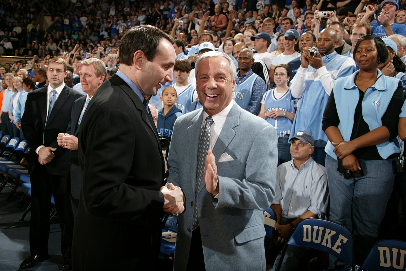 Mike Krzyzewski shakes hands with Roy Williams before a game in March 2006. Duke lost to North Carolina, 83-76.