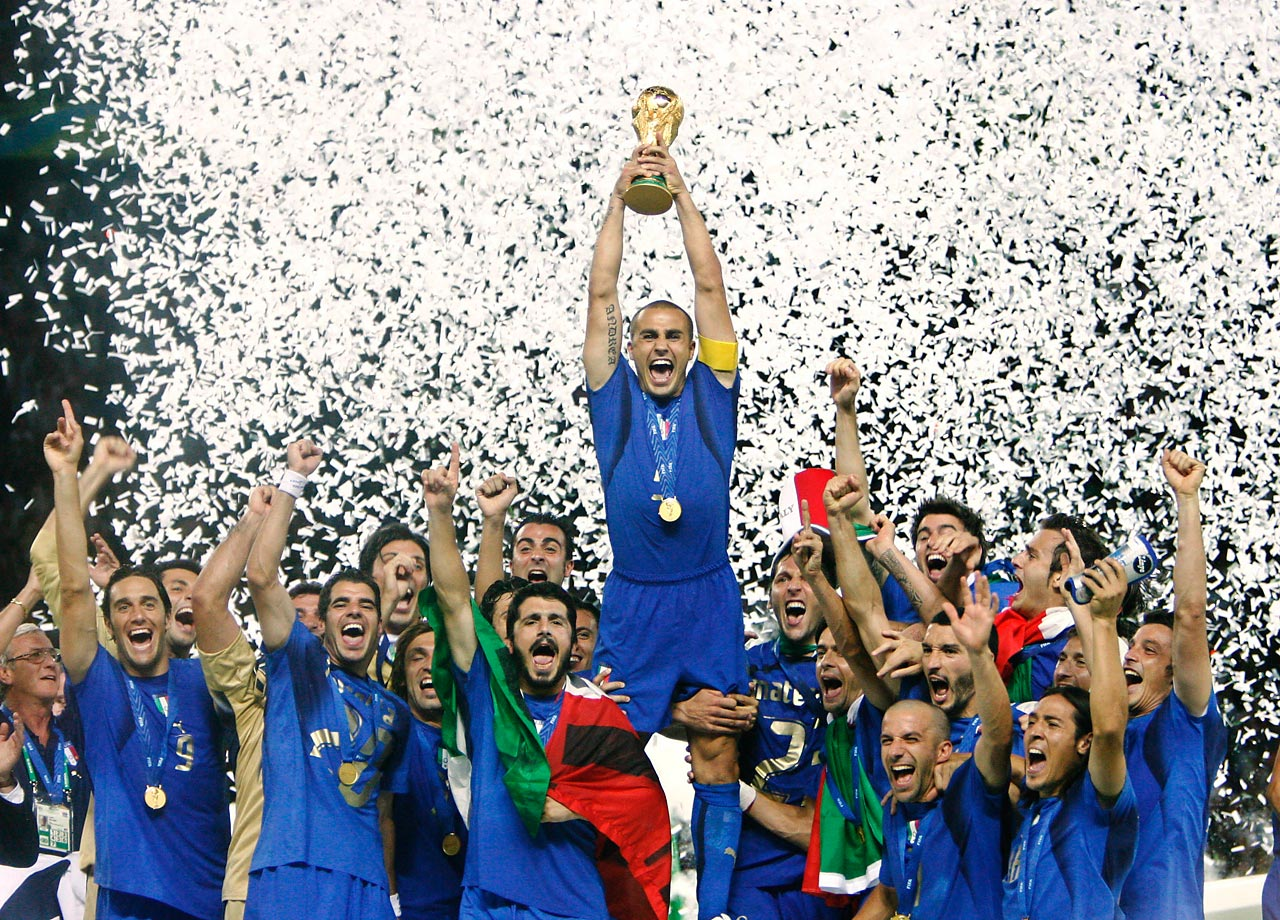 Italian captain Fabio Cannavaro lifts the trophy with confetti in the background after Italy defeated France, 5-3, in the penalty shootout of the 2006 World Cup final.