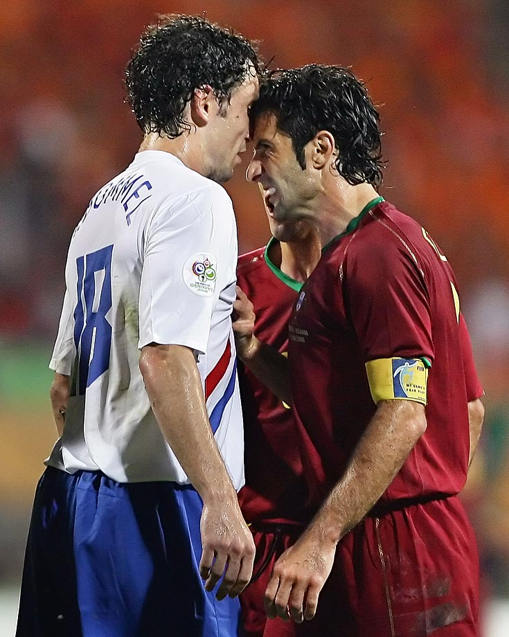 Luis Figo and Mark van Bommel go head-to-head in the Battle of Nuremburg, a World Cup match that set new records, featuring 4 red cards and 16 yellow cards in a physical match that had bad blood throughout.  Portugal eventually won to advance to the quarterfinals.
