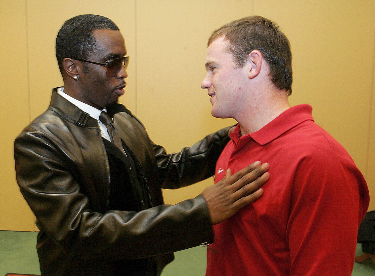 Combs speaks with Rooney prior to an appearance at the MTV European Music Awards on Oct. 31, 2006 in Copenhagen, Denmark.