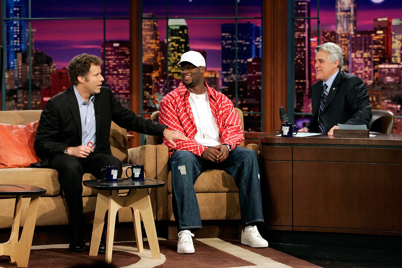 "Will Ferrell jokes with Rose Bowl MVP Vince Young of the Texas Longhorns during the ""Tonight Show with Jay Leno"" on Jan. 5, 2006 in Burbank, Calif."