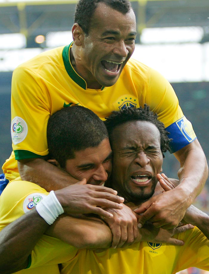 Brazil's Ze Roberto celebrates with teammates Cafu and Ricardinho after scoring in the Round of 16 match between Brazil and Ghana at the 2006 World Cup.