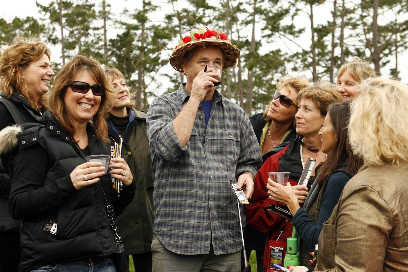 Bill Murray drinks wine with fans during the AT&T Pebble Beach National Pro-Am golf tournament on Feb. 8, 2007 in Pebble Beach, Calif.