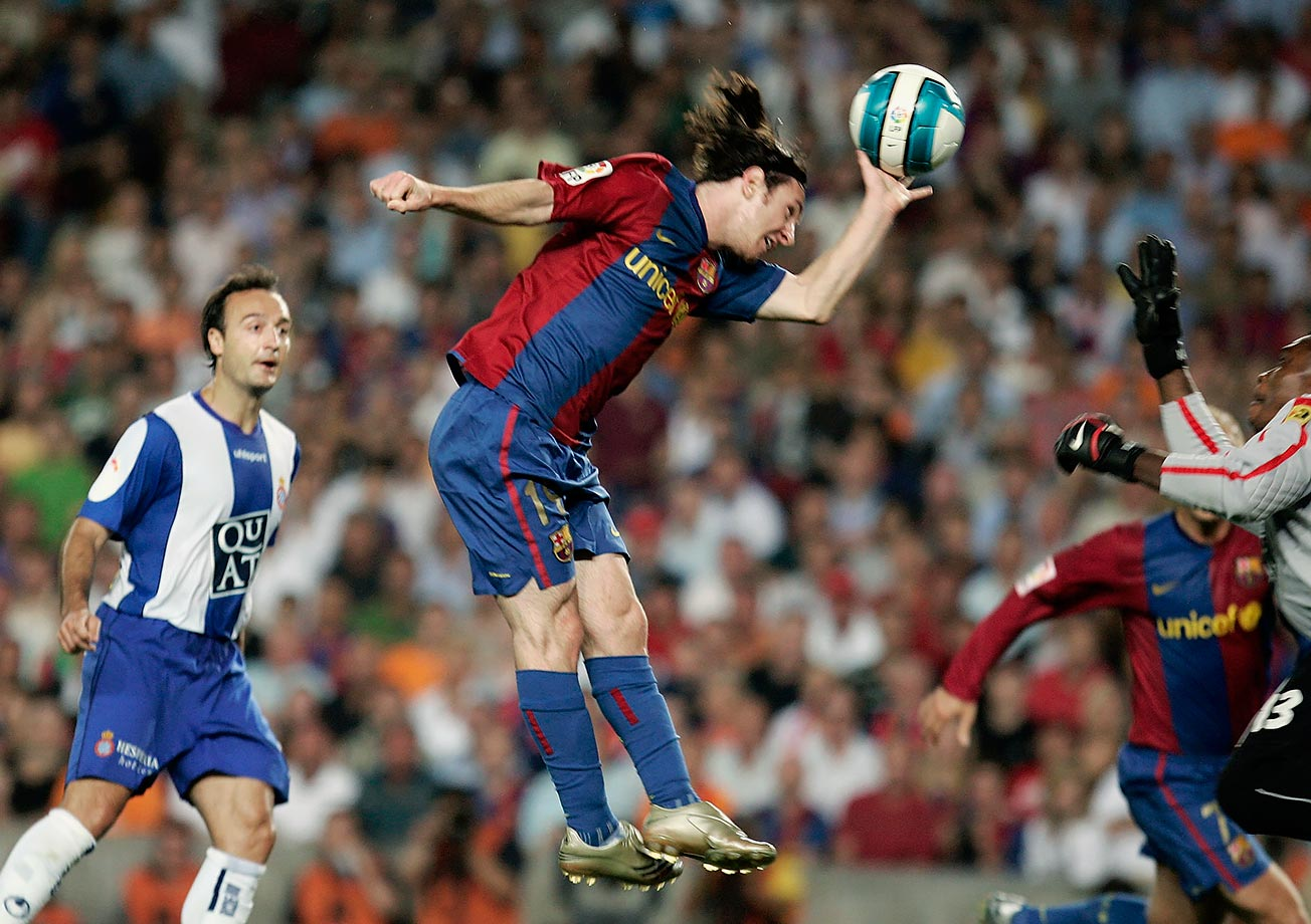Barcelona's Lionel Messi scores with his hand during a Spanish League match against Espanyol on June 9, 2007 at the Camp Nou stadium in Barcelona, Spain. Messi continued to draw comparisons with Argentine soccer legend Diego Maradona who scored in similar fashion during a quarterfinal World Cup match against England in 1986.