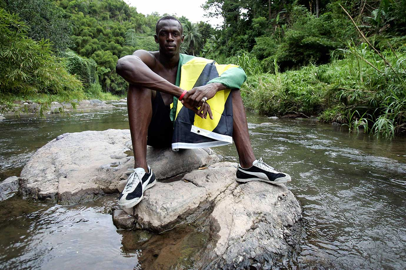 Bolt, pictured here in his native Jamaica, burst onto the track and field scene at 14. In 2002, at 16, Bolt set the world junior record for the 200 at 19.93 seconds.