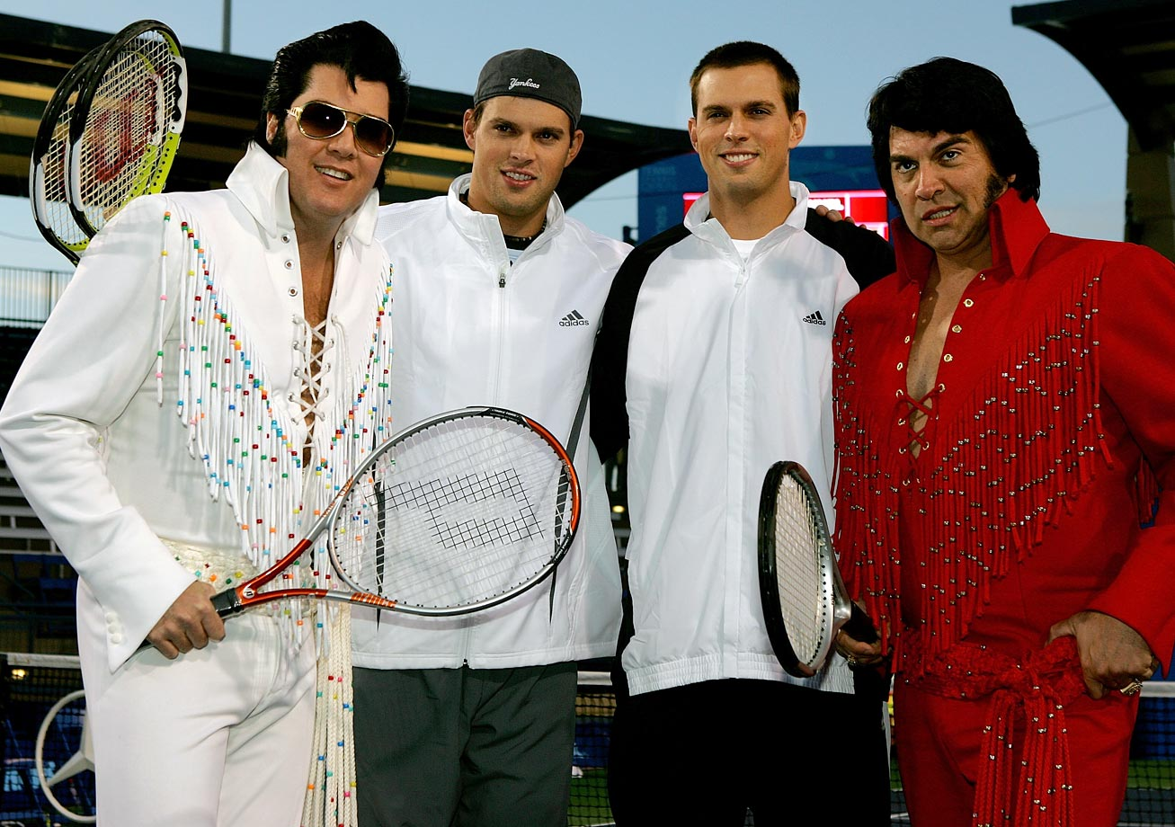 Bob and Mike Bryan pose with two Elvis impersonators before an exhibition match during the Tennis Channel Open at Darling Tennis Center in Las Vegas Feb. 26, 2007.