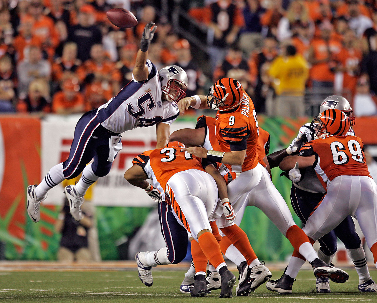 Tedy Bruschi leaps over the line of scrimmage to knock down a Palmer pass during a 2007 Monday night game.