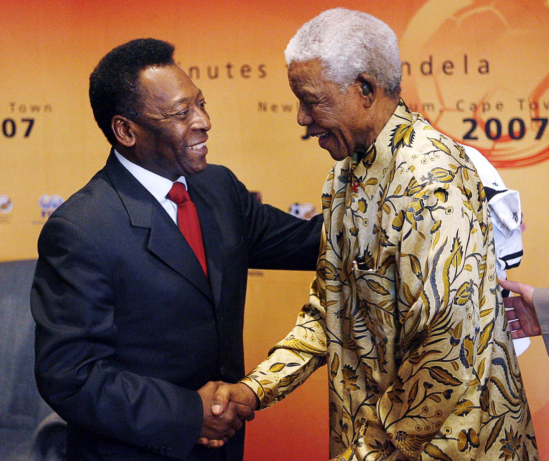 Brazilian football legend Pele greets Mandela the day before his 89th birthday. The ''90 Minutes for Mandela'' match, which Pele attended, was played the following day.