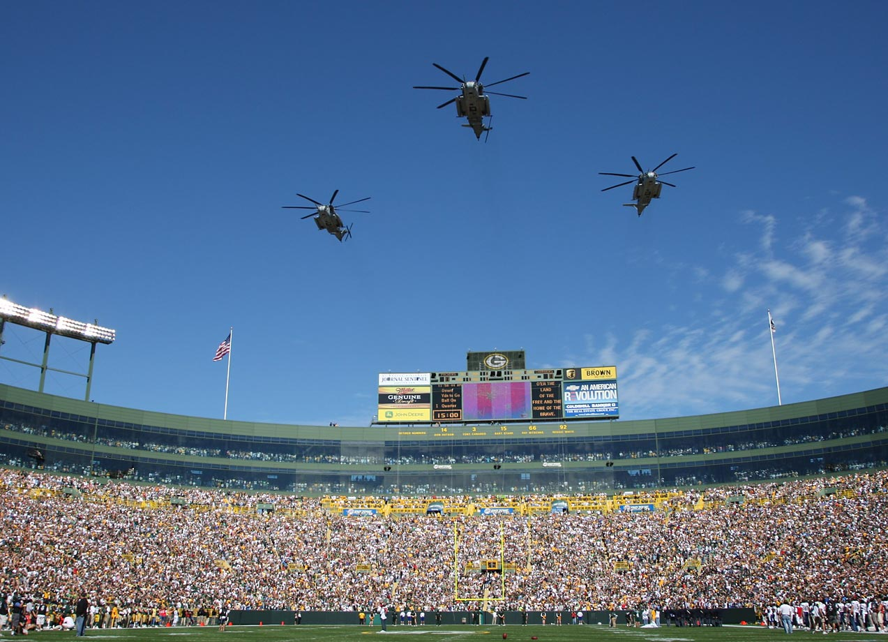 Helicopters fly over Lambeau Field before a Packers-Chargers game in September 2007.
